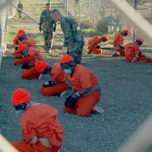 Camp X-Ray (Gitmo) detainees, 1/11/2002, Source: Wikipedia