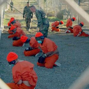 Camp X-Ray (Gitmo) detainees, 1/11/2002, Source: Wikipedia