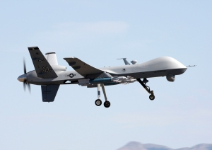 MQ-9 Reaper flies above Creech AFB during a local training mission.  (Photo by Paul Ridgeway; attained from Wikipedia)